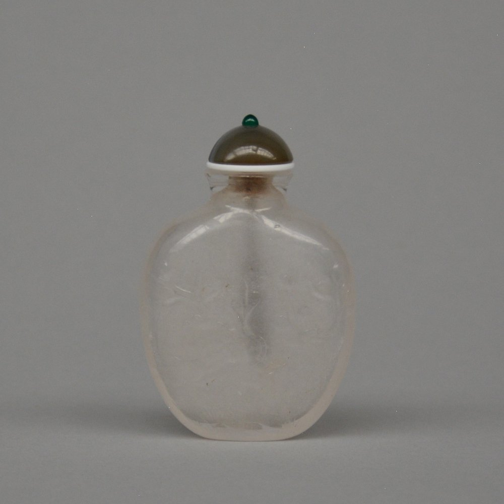 A Chinese rock crystal carved relief snuff bottle with