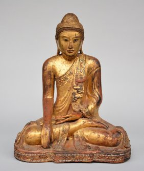 An Oriental Wood-core Dry-lacquer Sitting Buddha, Gilt