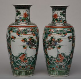 A Pair Of Chinese Famille Verte Vases Decorated With