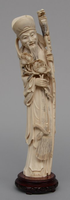 A Chinese Carved Ivory Figure On A Wooden Base, Ca.