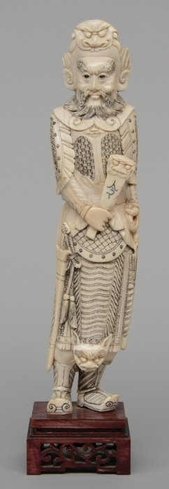 A Chinese Ivory Carved Warrior On A Wooden Base, Ca.