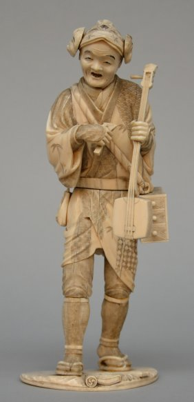 A Japanese Ivory Okimono Depicting A Peddler, Scrimshaw