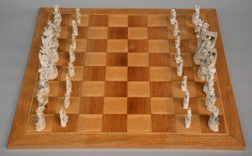 A Chinese Ivory Chess Set, Scrimshaw Decorated, With