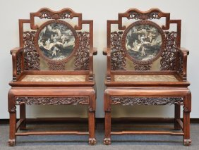 An Exceptional Pair Of Chinese Hardwood Armchairs With