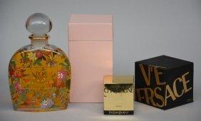 A Set Of Four Factice Perfume Bottles: Yves Saint