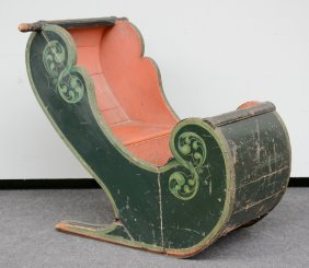 A Polychrome Wooden Children's Sleigh, 19thc, H 85 - W