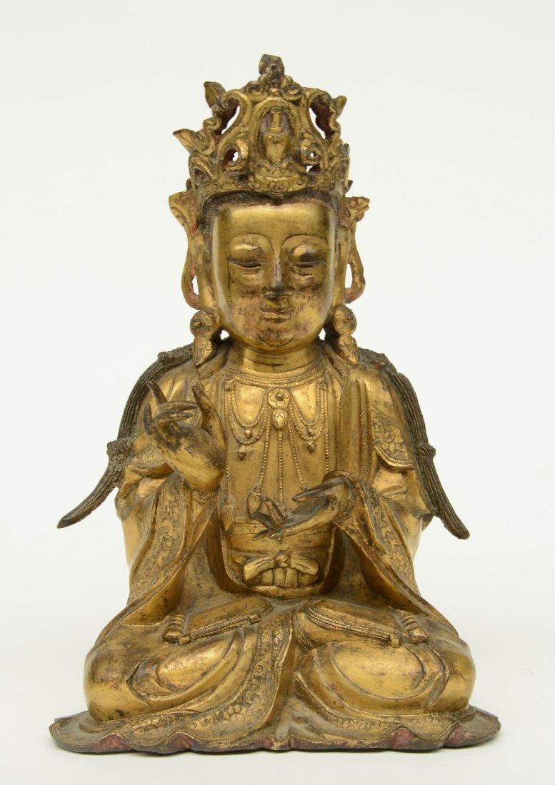 A Chinese gilt bronze Buddha, Ming, H 27,5 cm (traces