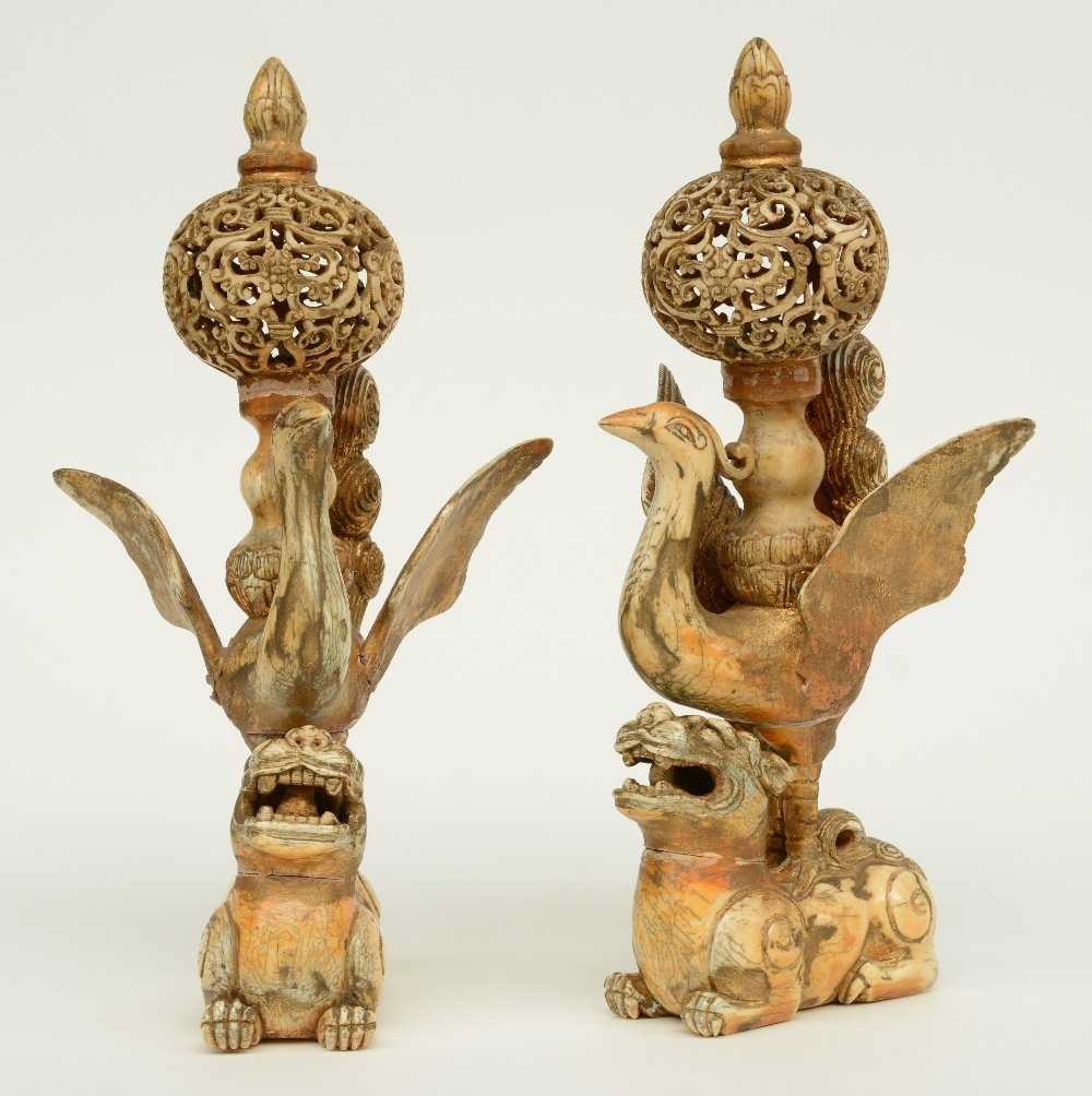 A pair of late 19thC - early 20thC ivory sculptures