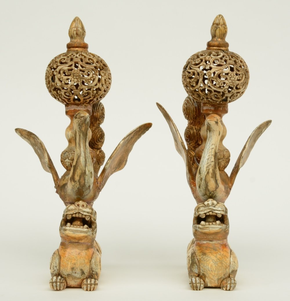 A pair of late 19thC - early 20thC ivory sculptures - 2