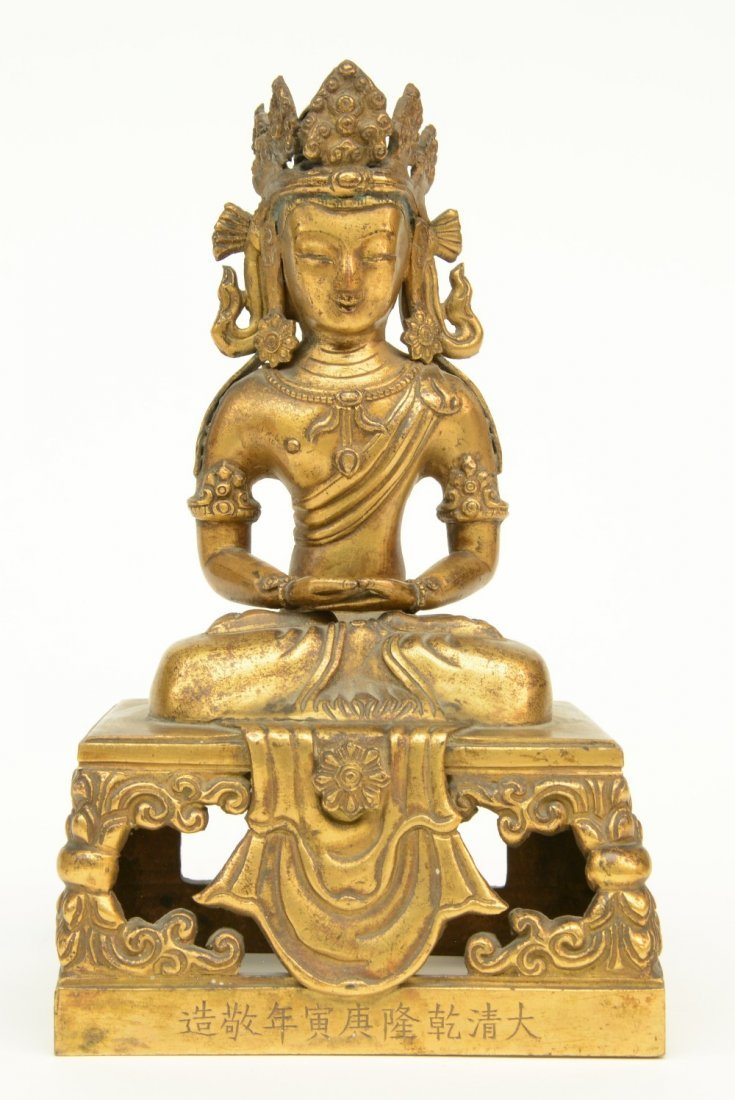 A Chinese gilt and polychrome decorated Buddha,