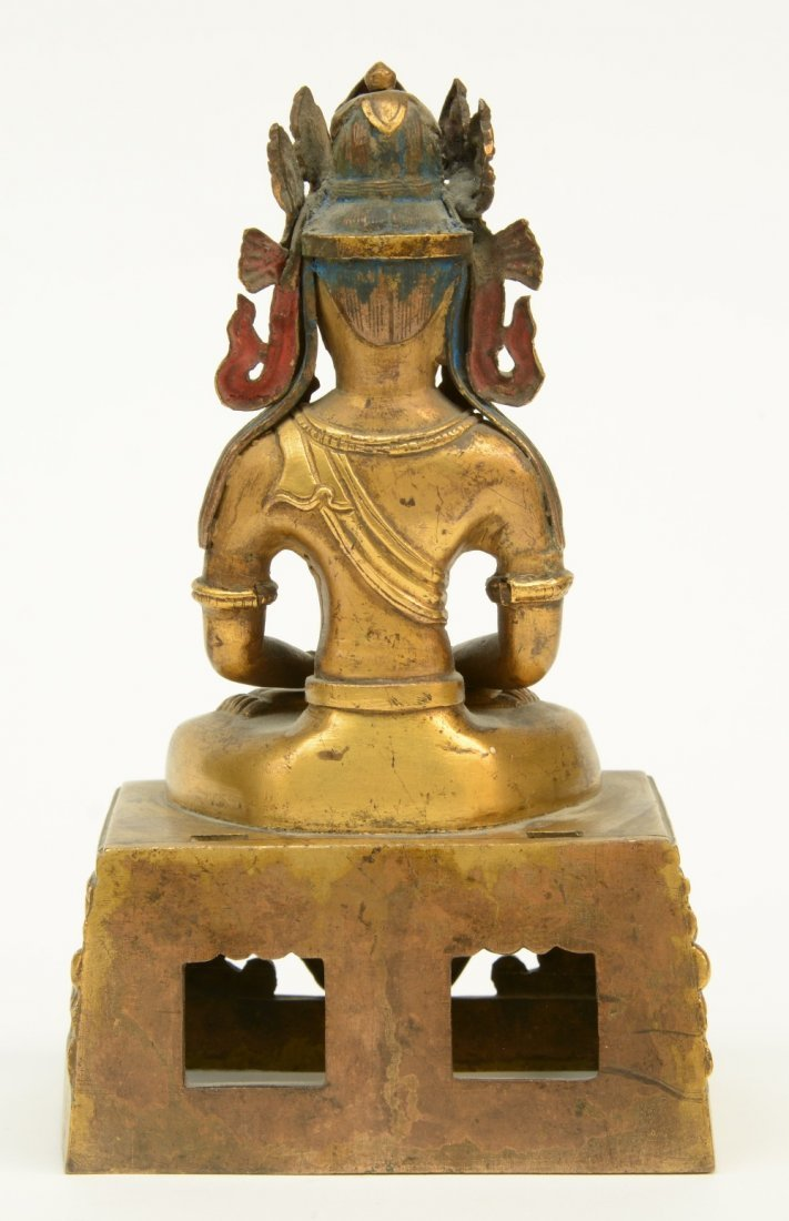 A Chinese gilt and polychrome decorated Buddha, - 3