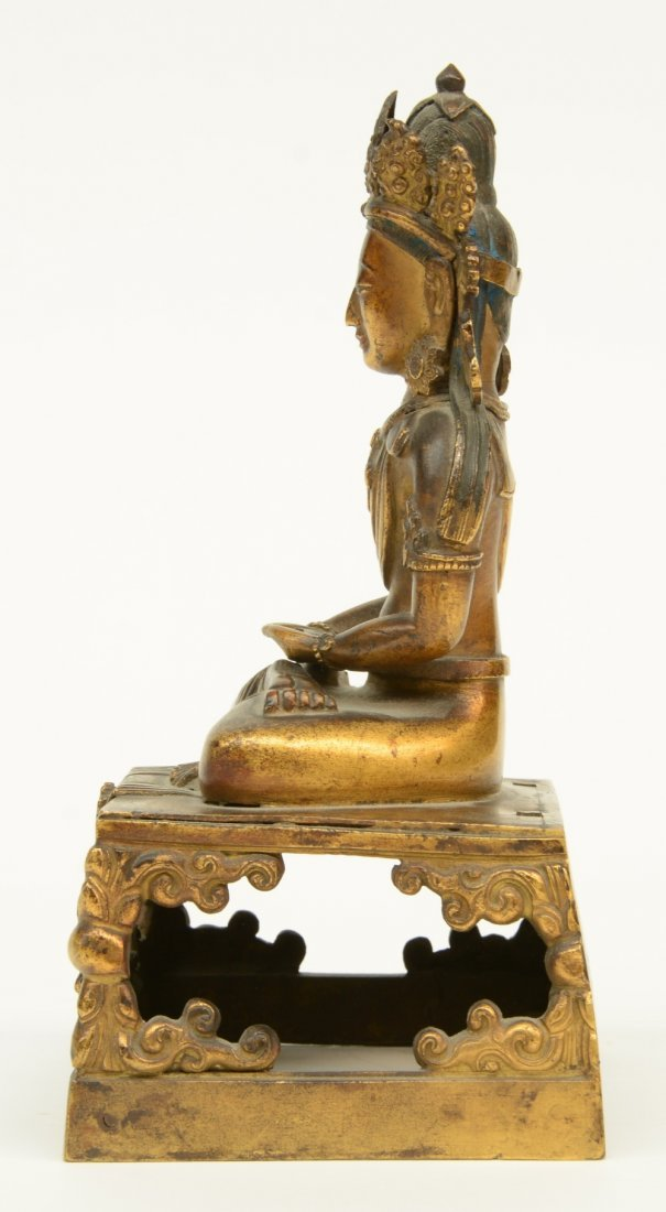 A Chinese gilt and polychrome decorated Buddha, - 2