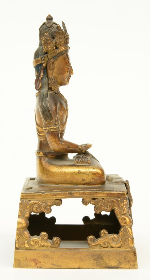 A Chinese gilt and polychrome decorated Buddha, - 4