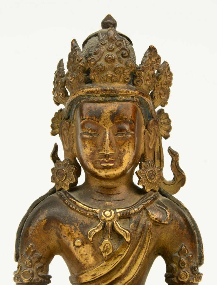 A Chinese gilt and polychrome decorated Buddha, - 5