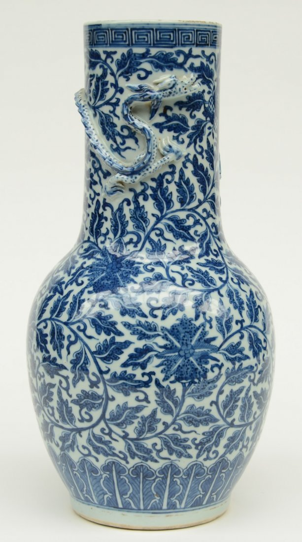 A Chinese blue and white and relief decorated vase,