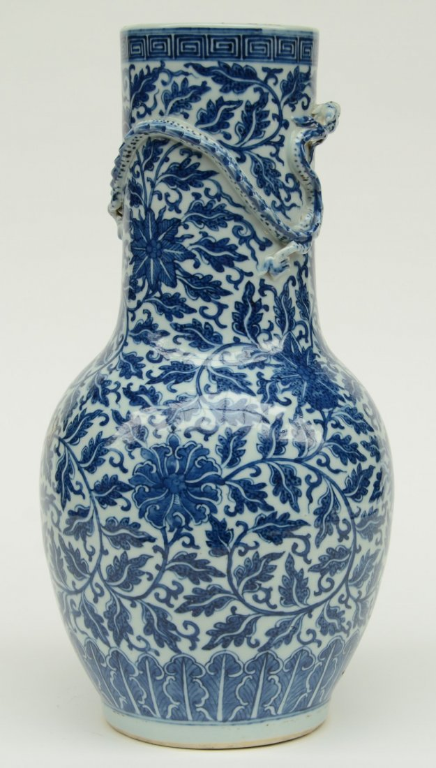 A Chinese blue and white and relief decorated vase, - 4