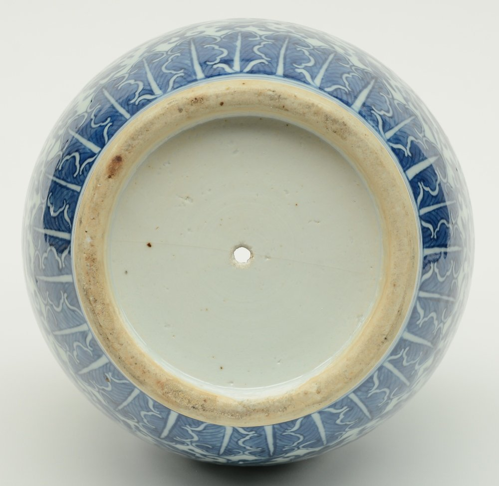 A Chinese blue and white and relief decorated vase, - 6