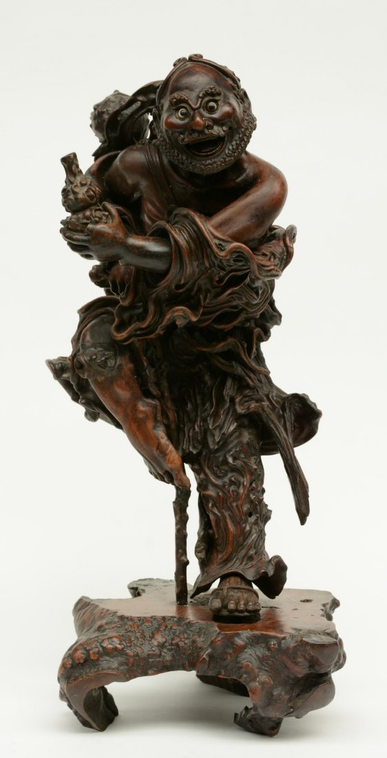 A Chinese walnut carved sculpture depicting a mythical