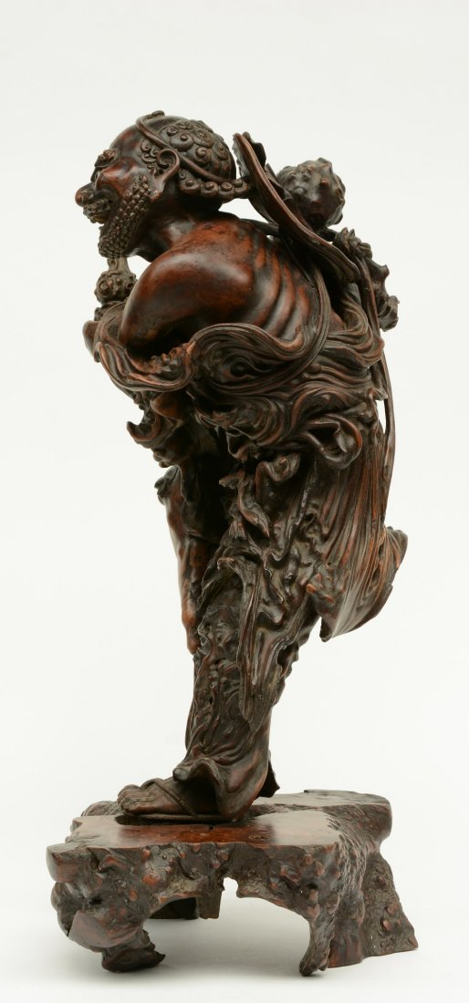 A Chinese walnut carved sculpture depicting a mythical - 2