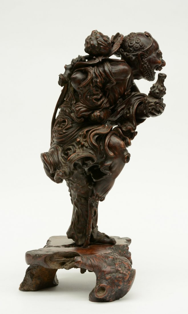 A Chinese walnut carved sculpture depicting a mythical - 4
