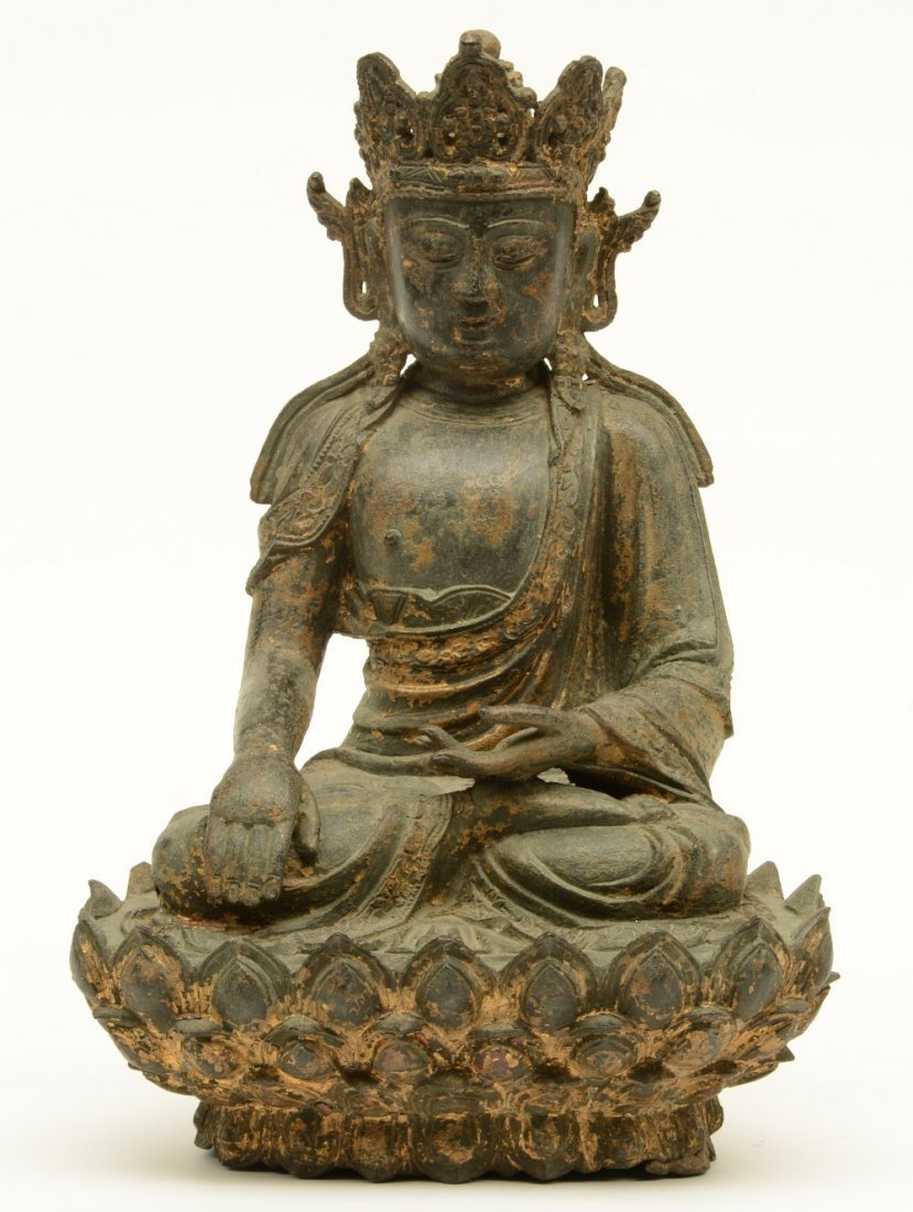 A Chinese bronze seated Buddha, traces of polychromy