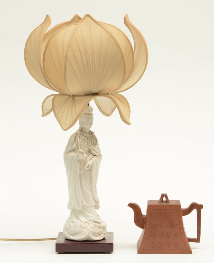 A Chinese Guanyin, Blanc de Chine, mounted into a lamp;