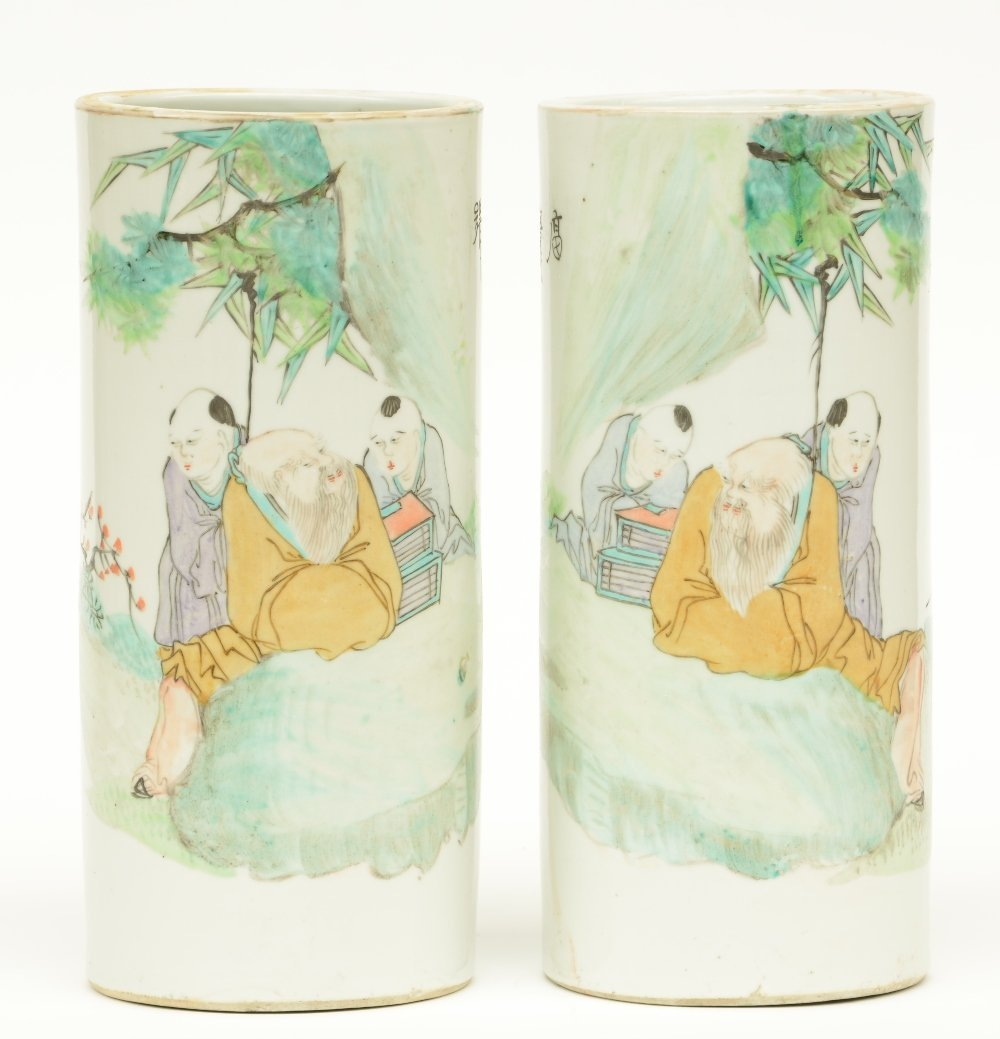 A pair of Chinese cylinder shaped polychrome vases,