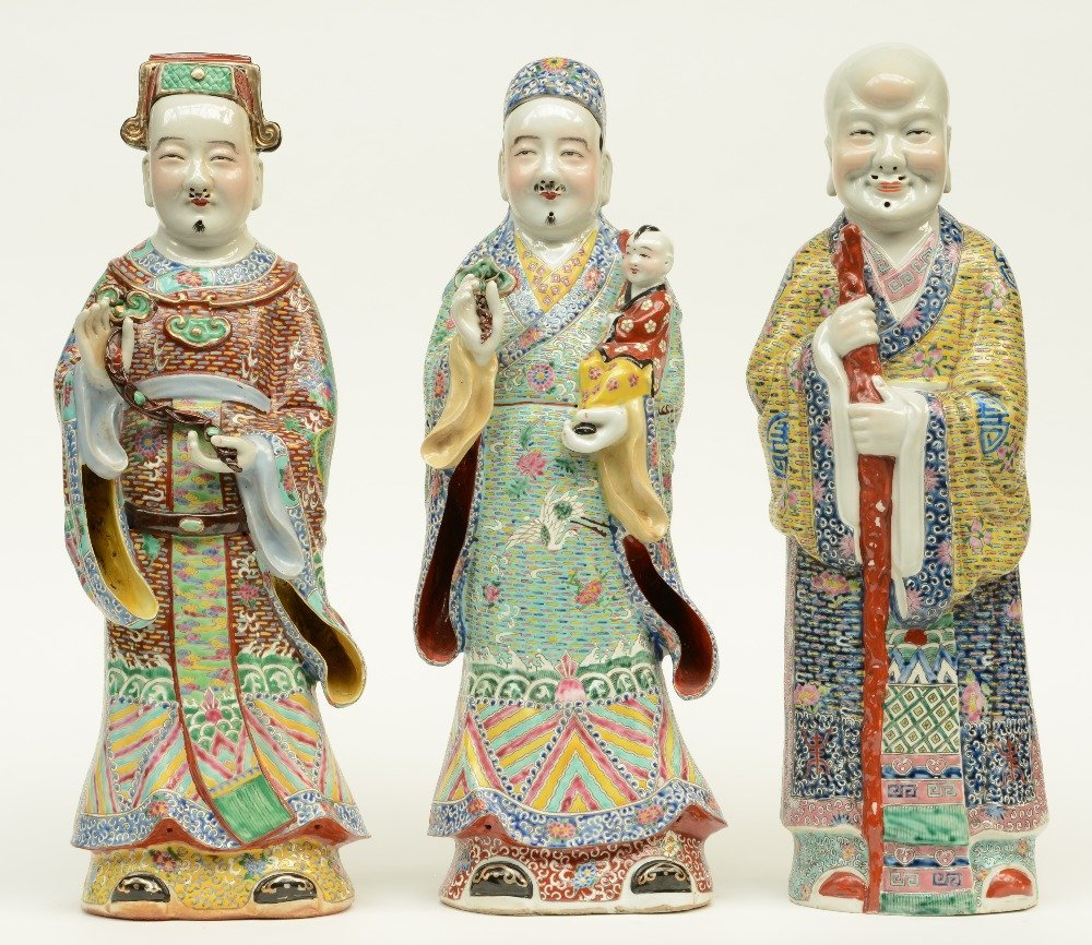 Three Chinese polychrome decorated 'Fu Lou Shou Xing'