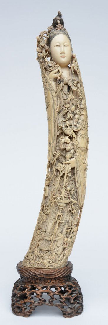 An exceptional and richly carved ivory Guanyin,