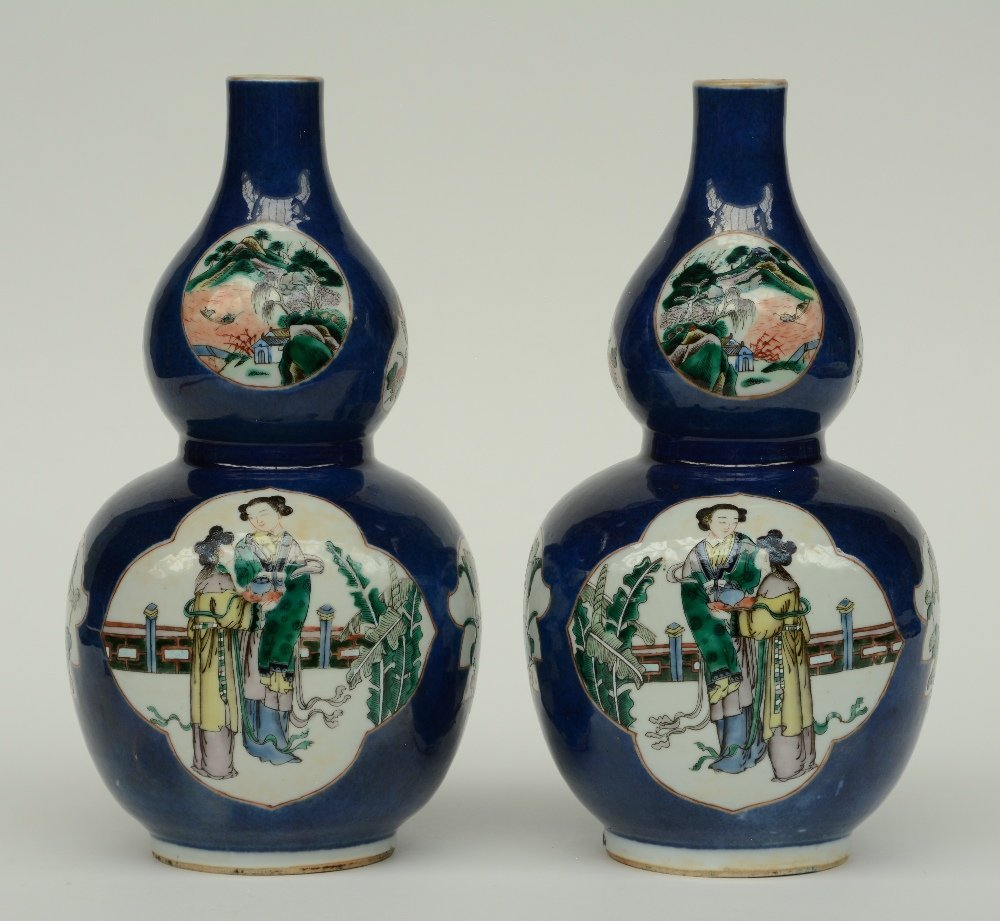 A pair of Chinese blue poudré double-gourd vases, the