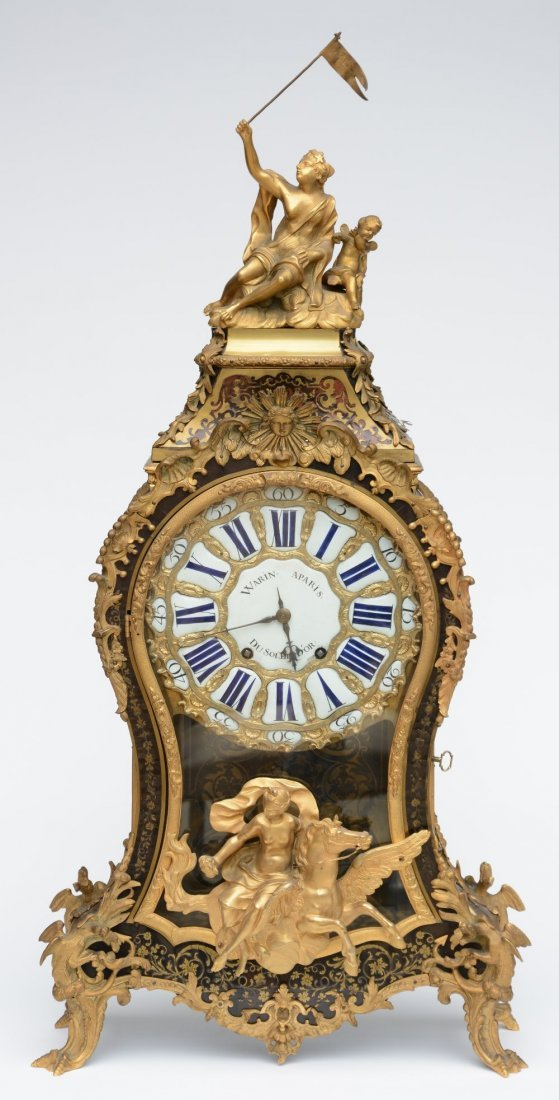 A rare cartel clock, tortoise shell veneered and with