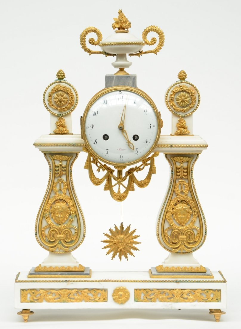 A rare Neoclassical mantel clock, white marble with