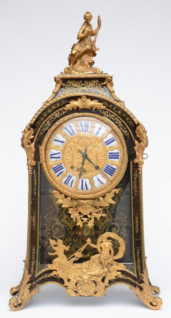 A rare LXIV style cartel clock, tortoise shell veneered