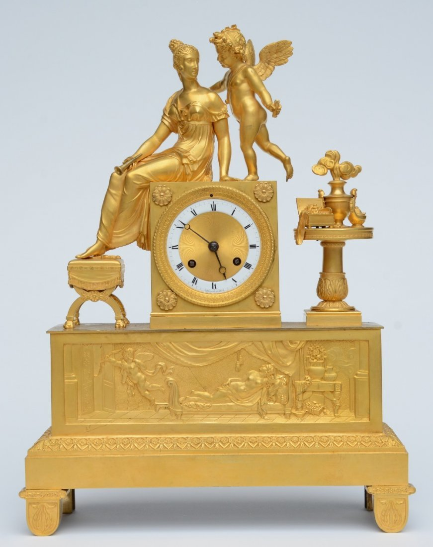 A rare ormolu mantel clock, decorated on top with Cupid