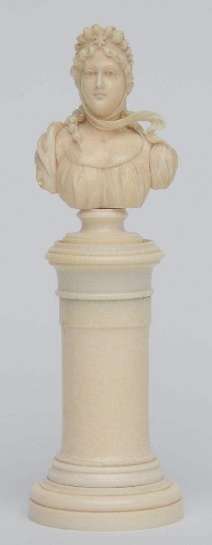 An exceptional finely carved ivory ladies bust on a