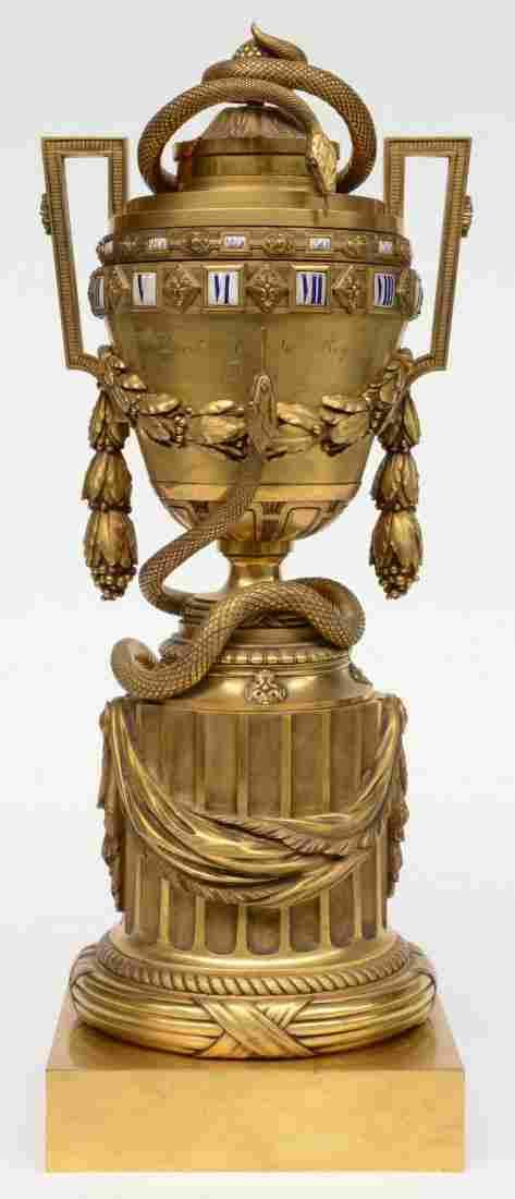 A rare French LXVI style gilt bronze 'Ã cercles