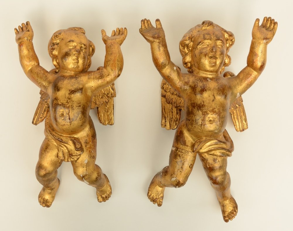 A pair of gilt limewood sculpted angels, Low Countries,
