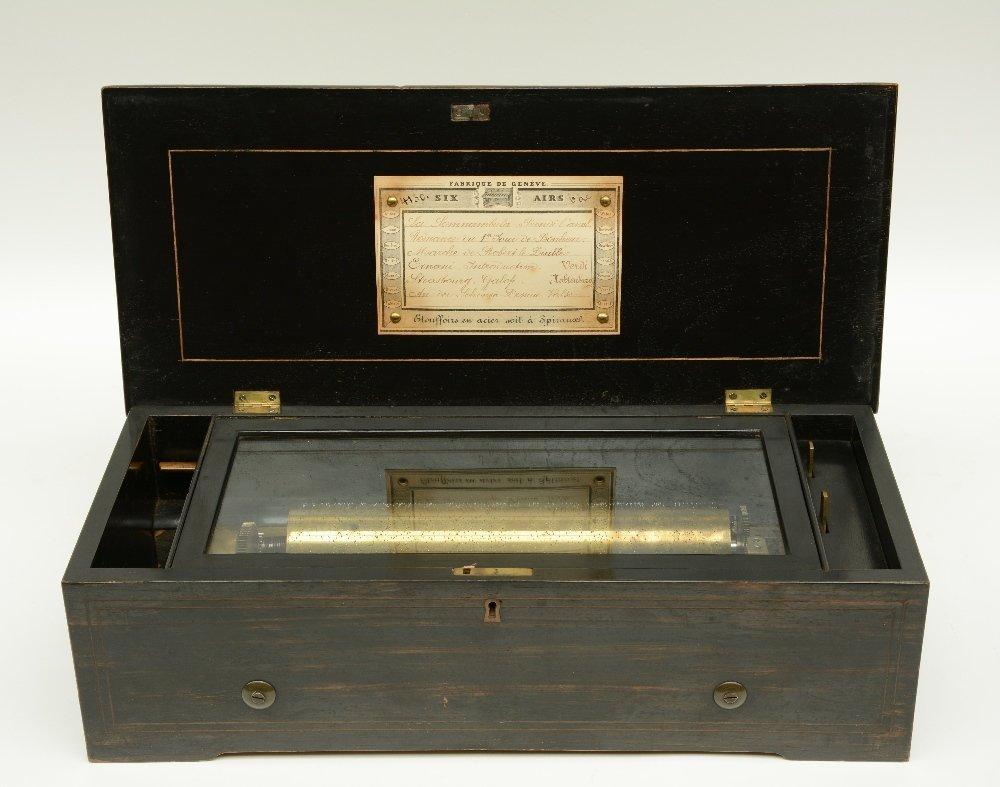 A 19thC ebonised and rosewood veneered music box,