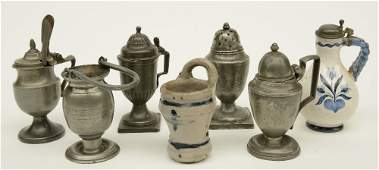 A lot three pewter mustard pots a caster and a Holy