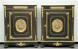A pair of Neoclassical ebonized cabinets, with gilt