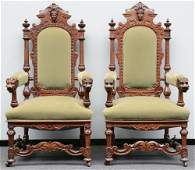 A pair of Renaissance style richly carved walnut