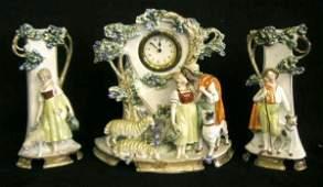 2089 German porcelain figural clock set