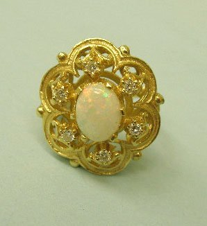 3050: Gold opal and diamond ring