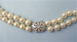 3147 Diamond clasped 20 double strand pearls