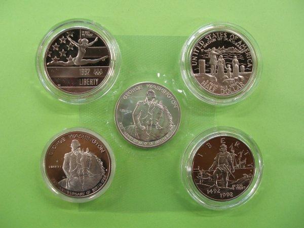2011: 5 unc + proof commemorative half dollars