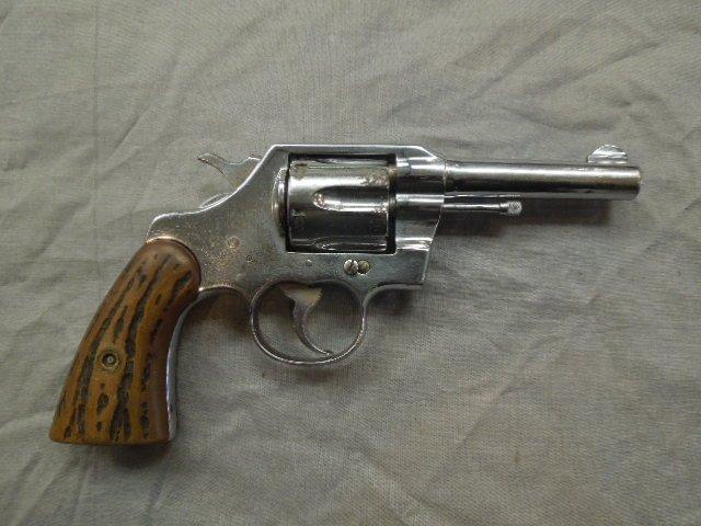 "Colt Official Police 4"" Revolver"