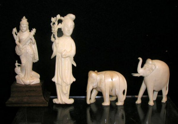 2000: Lot of 4 carved Ivory figures