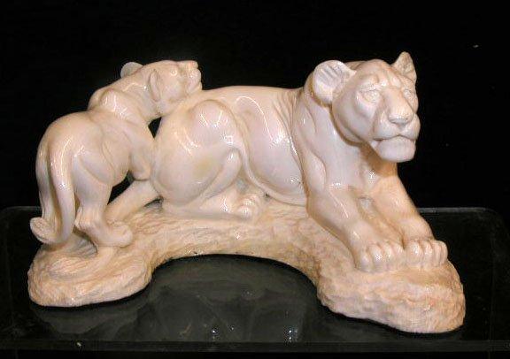 2001: Ivory lioness w/cob sculpture