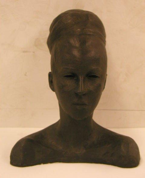 2008: Artist signed terra cotta female sculpture