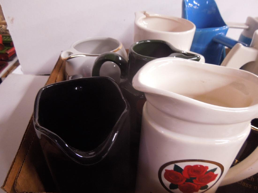 Porcelain Advertising Liquor Pitchers - 2